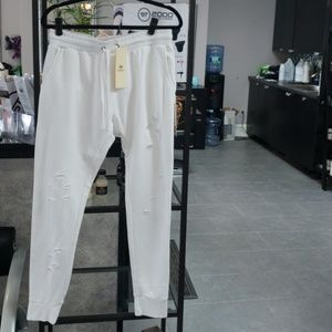 White torn joggers